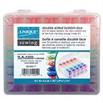 This handy, spill-proof plastic case is double sided and can hold up to 50 metal or plastic machine bobbins. An ideal solution for preventing tangled threads and keeping your bobbins organized and accessible. Secure hinges and latches ensure your bobbins stay in place. Includes 50 plastic bobbins in assorted colours. 12 x 11 x 4.7 cm (4 3/4″ x 4 1/4″ x 1 3/4″)