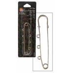 Kilt pin with loops for hanging beads, charms, chains et ornaments.